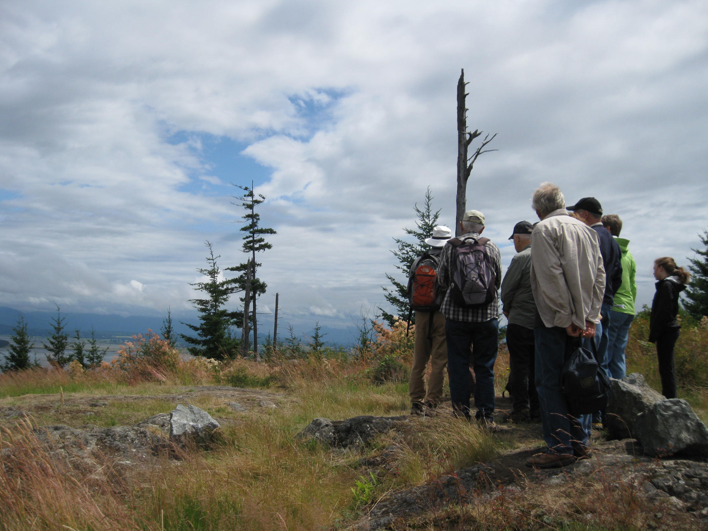 Community members participate in a tour of Guemes Mountain geology, July 2012. Photograph credit: Skagit Land Trust staff.