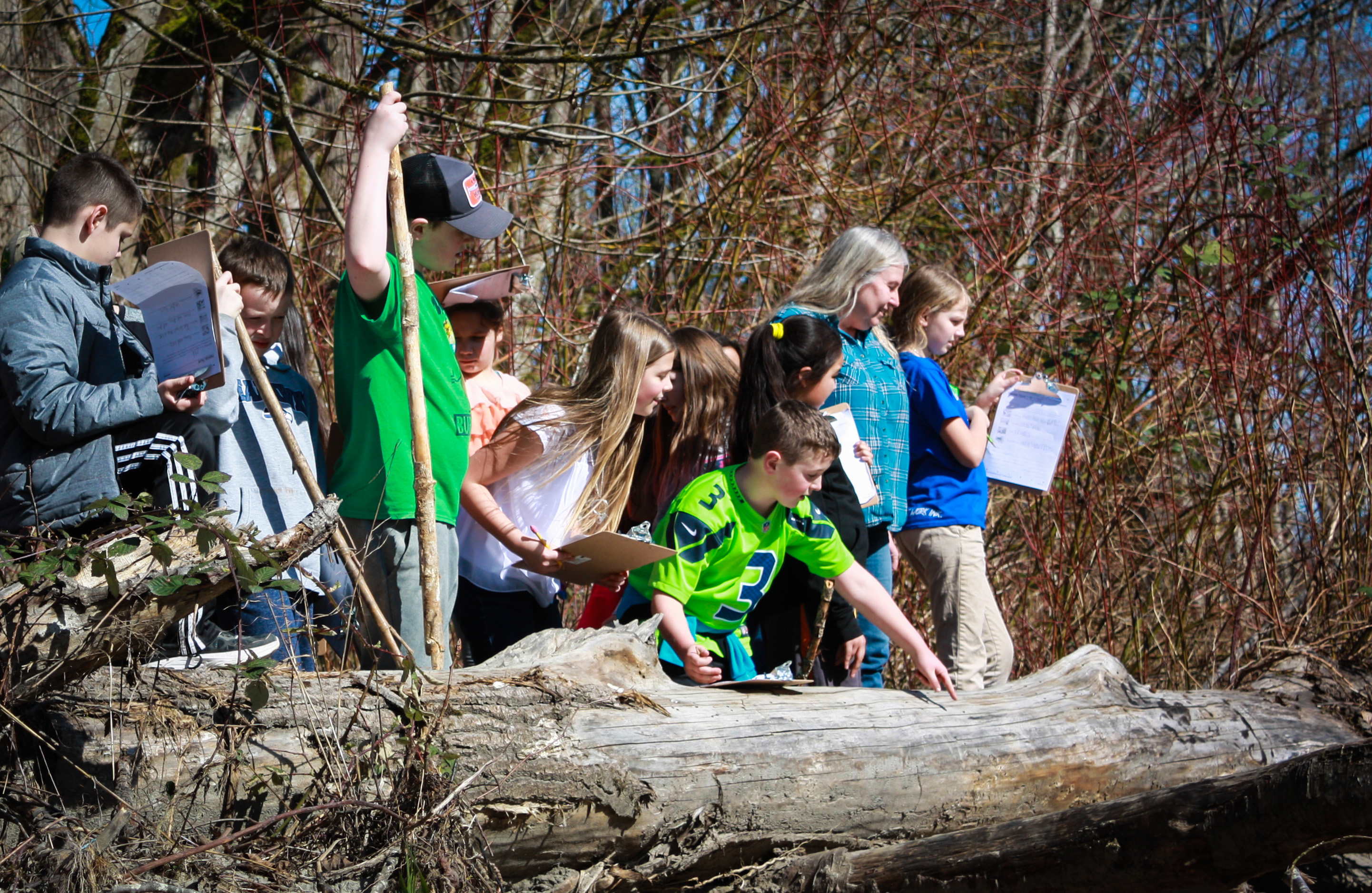 Fifth grade students from Lyman Elementary school participate in field-based environmental education at Lyman Slough, March 2018. Photograph credit: Skagit Land Trust staff.