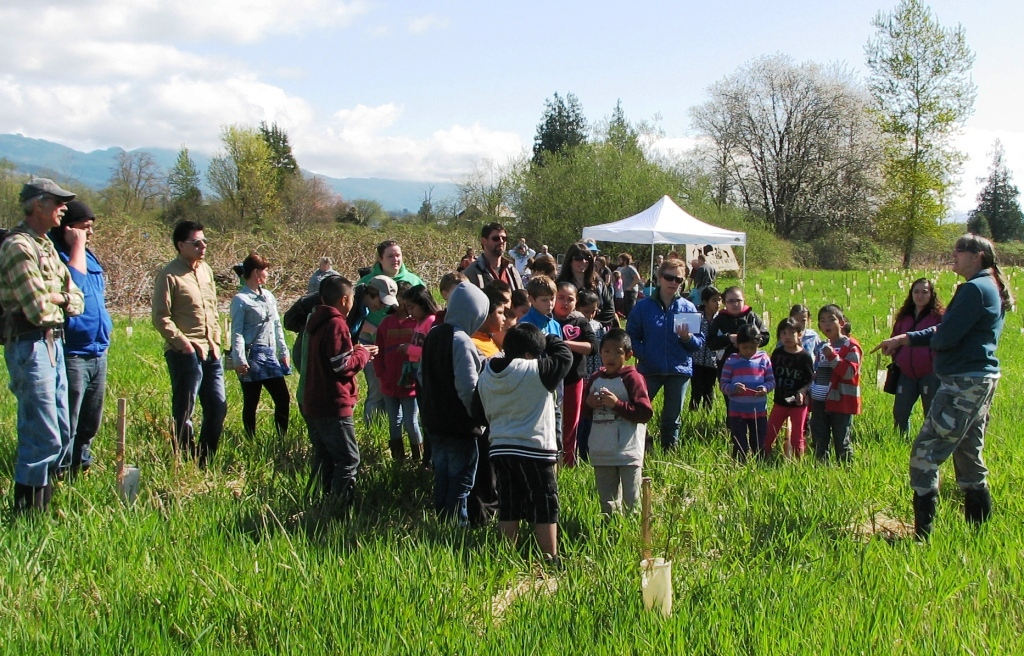 "Community members visit the Utopia Conservation Area for the ""Festival of Frogs"" during the spring of 2014. Photograph credit: Skagit Land Trust staff."